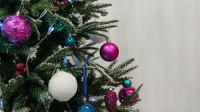 Christmas background. Close-up of decorations and balls on the New Year tree. Free space. Close-up of decorations and balls on the New Year tree. Christmas royalty free stock photo