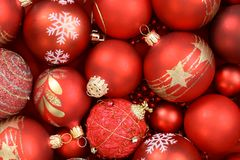 Christmas background. Close up of red Christmas ornaments stock images