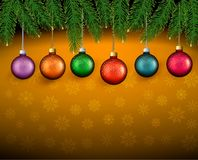 Christmas background with color balls and fir bran Royalty Free Stock Photos