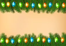 Christmas background with colorful garland and fir branches Royalty Free Stock Image