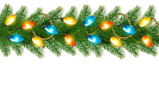 Christmas background with colorful garland and fir branches Royalty Free Stock Photos