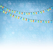 Christmas background with colorful garlands. Stock Photos