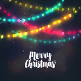 Christmas background with colorful light garlands Royalty Free Stock Photography