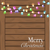 Christmas background with colorful light. Planked wood background Stock Images
