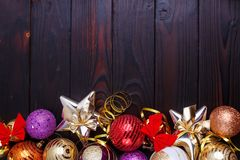 Christmas background, composition of festive decorations, stars. And baubles on dark wooden background with copyspace for your text design royalty free stock photography