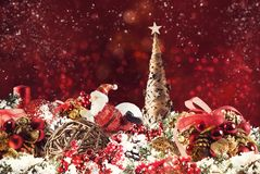 Christmas background concept. Shimmering Christmas decorations with tree, Santa Claus and candles. Xmas decoration background with balls for xmas tree and star royalty free stock image
