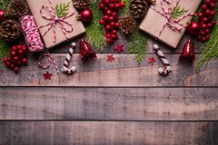 Christmas background concept. Top view of Christmas gift box red sock with spruce branches, pine cones, red berries stock photography
