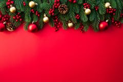 Christmas background concept. Top view of Christmas gift box red sock with spruce branches, pine cones, red berries. And bell on red background stock photography