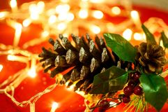 Christmas background with cone and blurred lights stock images
