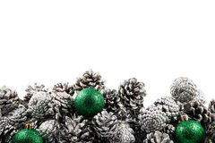 Christmas background with cones and balls. Space Royalty Free Stock Photo