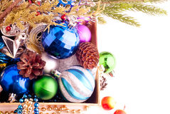 Christmas background with cones, color balls and berries Royalty Free Stock Photo