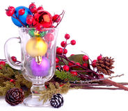 Christmas background with cones, color balls and glass Royalty Free Stock Image
