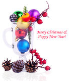 Christmas background with cones, color balls and glass Royalty Free Stock Photos