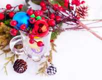Christmas background with cones, color balls and glass Royalty Free Stock Images