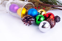 Christmas background with cones, color balls and glass Stock Photography