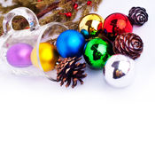 Christmas background with cones, color balls and glass Stock Images