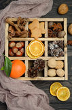 Christmas background with Cones, Gingerbread Cookies, Nuts, Spices and Dried oranges. Stock Images