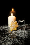 Christmas Background with Cookie, Cookie cutter and a candle in Stock Photo