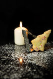 Christmas Background with Cookie, Cookie cutter and a candle in Stock Images