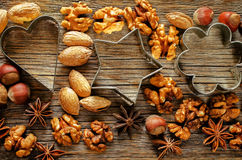 Christmas background with cookie cutters, nuts and anisetree Stock Photo
