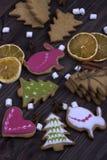 Christmas background cookie orange marshmellow brown wooden table. royalty free stock photos