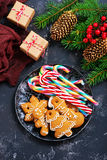 Christmas background. Cookies and candycane on a table, christmas background Royalty Free Stock Photos