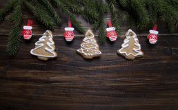 Christmas background with cookies decorated with icing, with clo Stock Photo