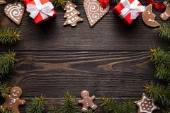 Cookies, gifts, spruce tree and decorations on wooden table royalty free stock photo