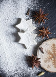Christmas background. Christmas cookies and spices on black stone background Stock Photos