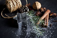 Christmas background. Christmas cookies and spices on black stone background Stock Images