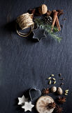 Christmas background. Christmas cookies and spices on brown wooden background Royalty Free Stock Image