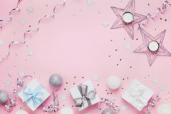 Christmas background with copy space for greeting text. Gift boxes and decoration on pink table top view. Flat lay. Stock Photography