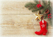 Christmas background with cowboy shoe decoration. Toys.Wood texture for text stock photography