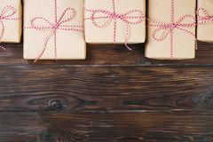 Christmas background with craft gift boxes on wooden background Stock Photos