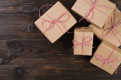 Christmas background with craft gift boxes on wooden background Royalty Free Stock Images