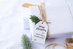 Craft and handmade Christmas present gift boxes with tag. royalty free stock image