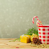 Christmas background with cup and decorations over dreamy blur background Stock Image