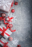Christmas background with cut paper snowflakes, gift boxes and decorations, top view Stock Image