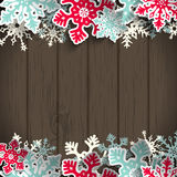 Christmas background with dark wood and snowflakes Royalty Free Stock Photography