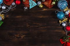 Christmas dark wooden background. Christmas toys. Christmas decorations. Christmas bright background a dark wooden table. Christmas decorations. Christmas toys stock images
