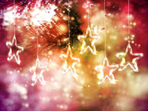 Christmas background of de-focused lights with decorated Glass Stars Royalty Free Stock Photos