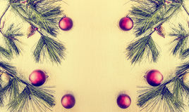 Christmas background with deco baubles and fir branches Stock Images