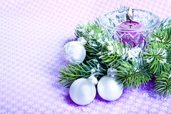Christmas background. Christmas decor with white balls, pine and candle Stock Images