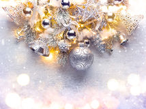 Christmas background decorated with baubles and light garland Stock Photo