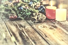 Christmas background, Christmas decorated fir tree, gifts, candles, gifts. Festive bokeh. Christmas bokeh. Gold glitter, snow fall Royalty Free Stock Photo