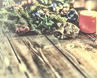 Christmas background, Christmas decorated fir tree, gifts, candles, gifts. Festive bokeh. Christmas bokeh. Gold glitter, snow fall Stock Photography