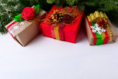 Christmas background with decorated gift boxes and Christmas tree royalty free stock images