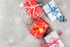 Christmas background with gifts. Christmas background with decorated gifts. Gray background, snow effect, Top view copy space Royalty Free Stock Images