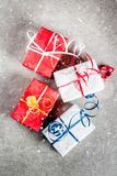Christmas background with gifts. Christmas background with decorated gifts. Gray background, snow effect, Top view copy space Stock Photo