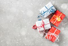 Christmas background with gifts. Christmas background with decorated gifts. Gray background, snow effect, Top view copy space Royalty Free Stock Photo